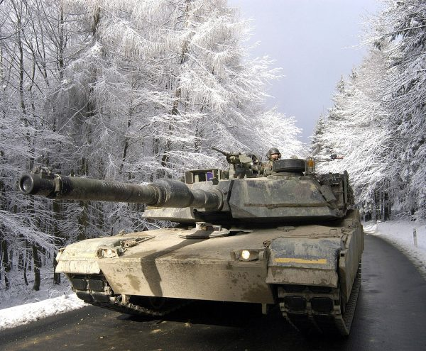 Tankers drive an M1A1 Abrams through the Taunus Mountains north of Frankfurt during Exercise Ready Crucible in February 2005.
