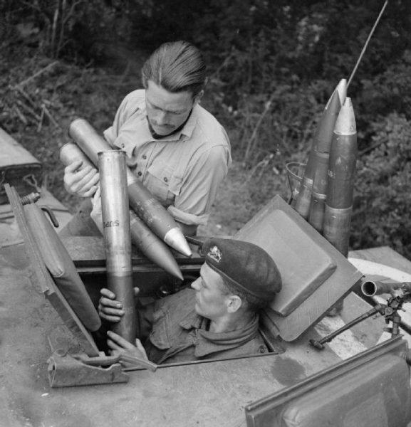 Loading ammunition into a Churchill tank, Normandy July 1944