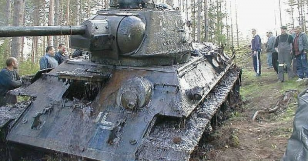 T-34 With German Markings Pulled From Bog After 60 years