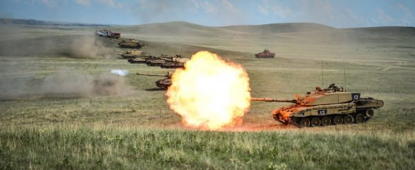 A row of Challenger 2s on a firing range at BATUS, Canada