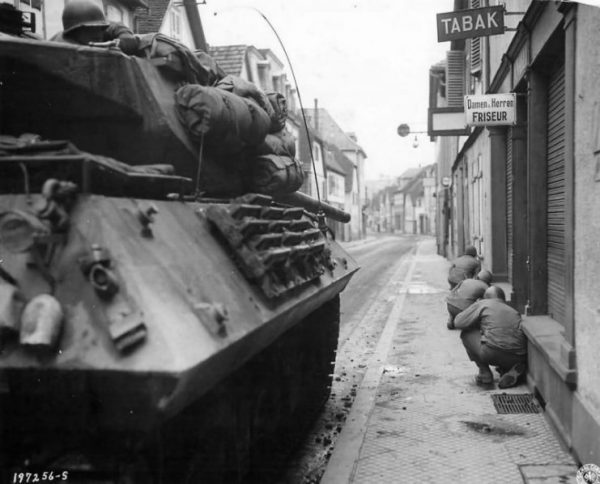157th Infantry Regiment Supported By M10 Tank Destroyers Of A Company 645th Tank Destroyer Battalion Under Fire In Town Of Niederbronn France