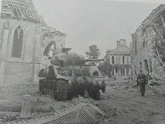 A knocked-out Sherman tank in the centre of Lingèvres, 20 June 1944