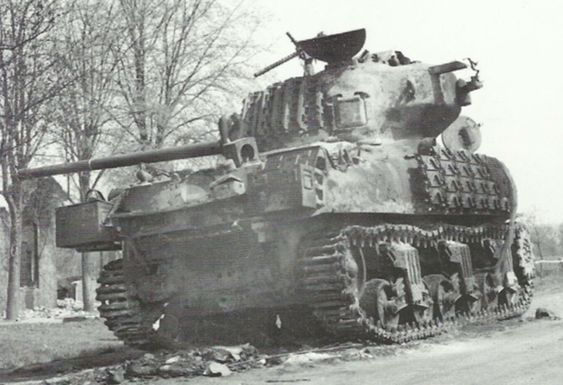 Burned out Commonwealth Sherman IIB (M4A1 76W); note the rubber burned off of the tracks