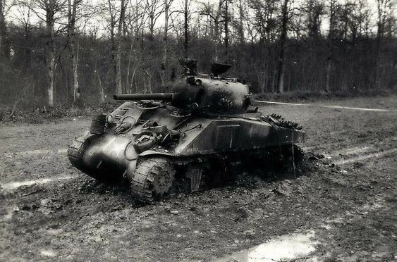 """""""Bar Fly"""" an M4 Sherman of the 6th Armored Division knocked out by a German land mine near Hellimer France, November 1944"""