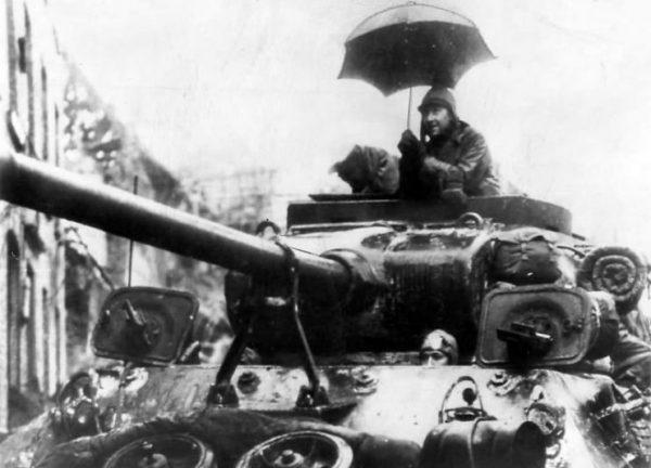 9th Army soldier under umbrella atop M36 Jackson – Germany 1945