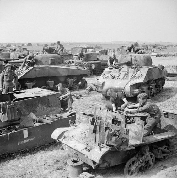 The remains of Sherman tanks and carriers waiting to be broken up at a vehicle dump in Normandy, 1 August 1944.