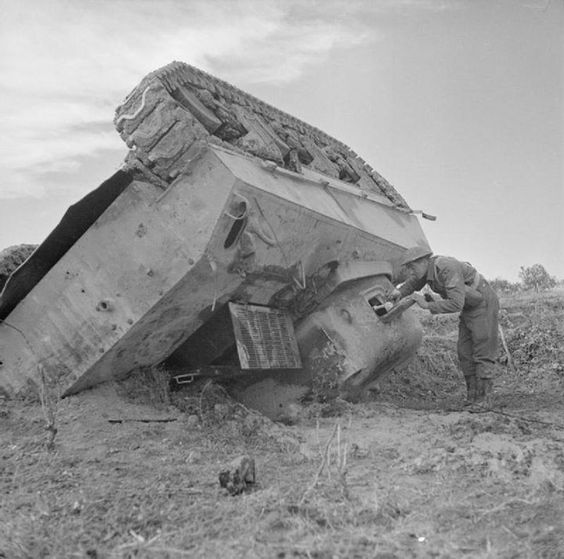 Tipped over British Sherman III (M4A2)
