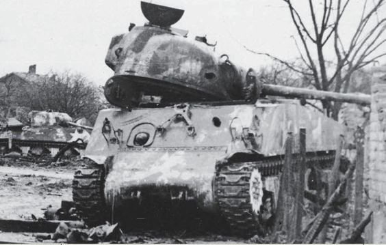 A pair of M4A3s of the 12th Armored Division following the fighting in Herrlisheim. Most of the 43rd Tank Battalion was knocked out in this battle