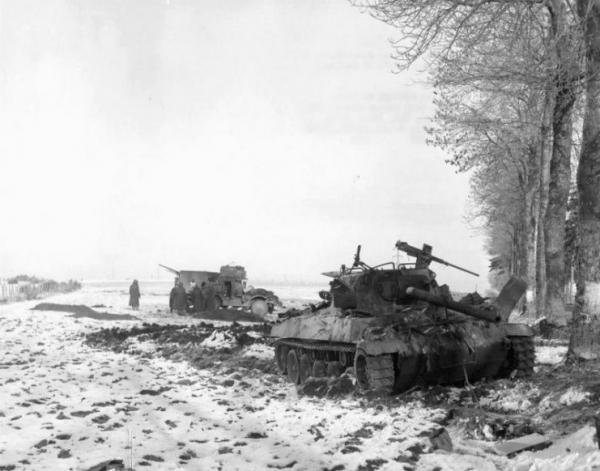 Destroyed M18 and halftrack