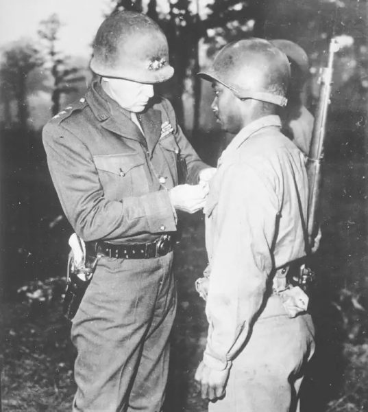 General George S. Patton pinning the Silver Star on Private Ernest A. Jenkins of the 761st Tank Battalion for his conspicuous gallantry in the liberation of Chateaudun, France, 1944. Courtesy of the U.S. National Archives