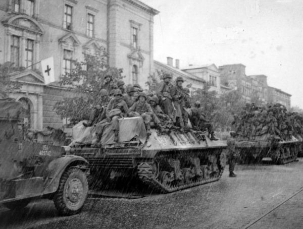 M36 and 3rd Division troops move to the front in hailstorm at Augsburg, Germany April 1945