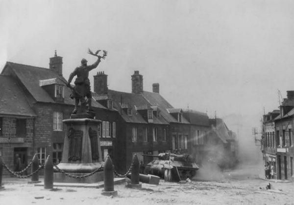 Tank Destroyer passes WWI Memorial in Lonlay-l'Abbaye, 1944