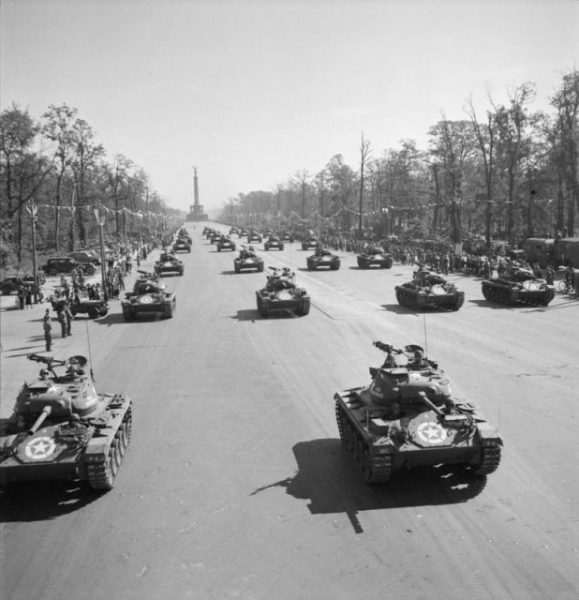 Germany Under Allied Occupation American Light Tanks drive down the Charlottenburg Chaussee in Berlin during the Four Nations VJ Day parade.