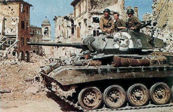M24 Chaffee of the 81st Reconnaissance Squadron, 1st Armored Division passes through ruins of Vergato (Bologna, Italy) on 14 April 1945