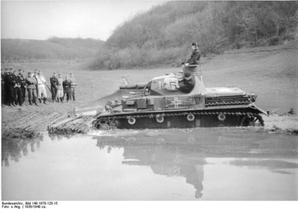 A Panzer IV-A performing a water crossing exercise demonstration while being observed by Wehrmacht officers on the shore. Bundesarchiv, Bild 146-1978-120-15 CC-BY-SA 3.0