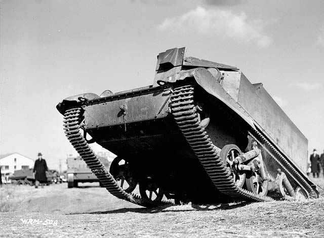 Army vehicle (Universal Carrier) being driven up a slope.Photo BiblioArchives LibraryArchives CC BY 2.0