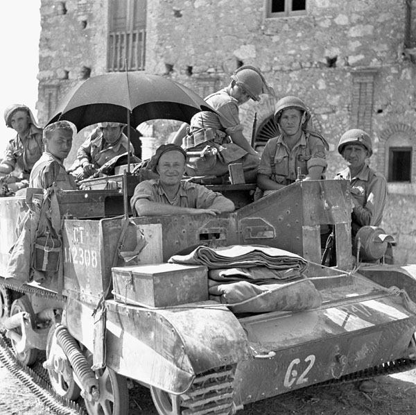 Infantrymen of the Edmonton Regiment in a Universal Carrier, using an umbrella to provide some shade. Photo BiblioArchives LibraryArchives CC BY 2.0