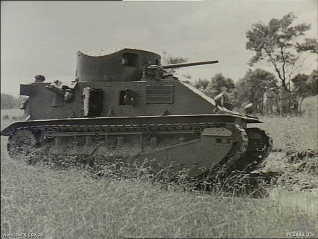 Side view of a Vickers Mark 2 Medium tank on manoeuvres. This tank weighs fifteen tons and is armed with a 47mm main gun and three .303 machine guns.