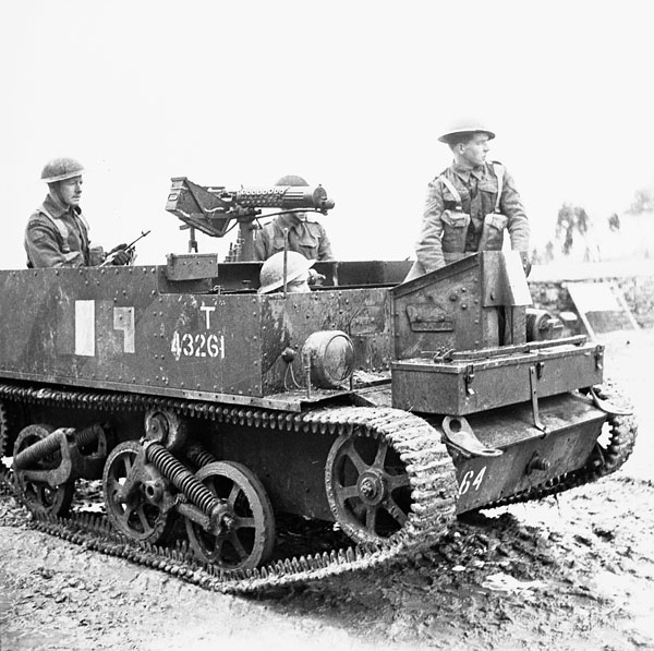 Unidentified personnel of the Saskatoon Light Infantry (M.G.) in a Universal Carrier equipped with a Vickers machine gun, Italy