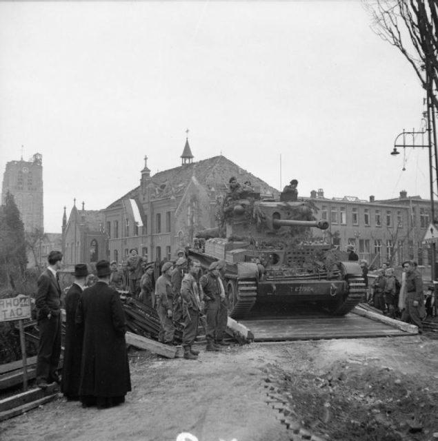A Challenger tank crosses a Bailey bridge near Esch, Netherlands. 27 October 1944
