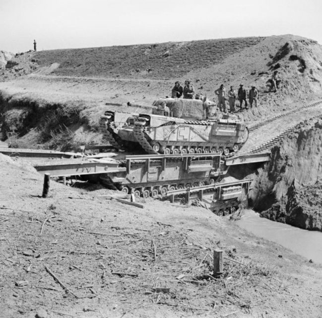 A Churchill tank of the North Irish Horse crossing the Senio in Italy on two stacked Churchill ARKs, April 1945