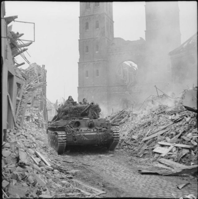 A King's Royal Hussars Cromwell of the 11th armoured division advances through Uedem, Germany, 28 February 1945