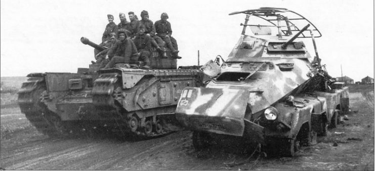A Soviet Churchill Mk IV passes a knocked-out German Sd.Kfz 232 (8-Rad) armoured car at the fourth battle of Kharkov in 1943
