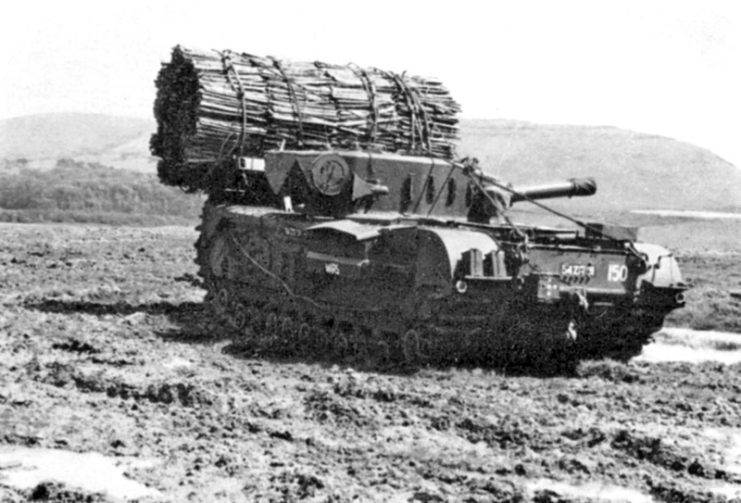 Churchill AVRE with fascine on tilt-forward cradle. This particular example is a post-WW2 AVRE on the MK VII chassis.