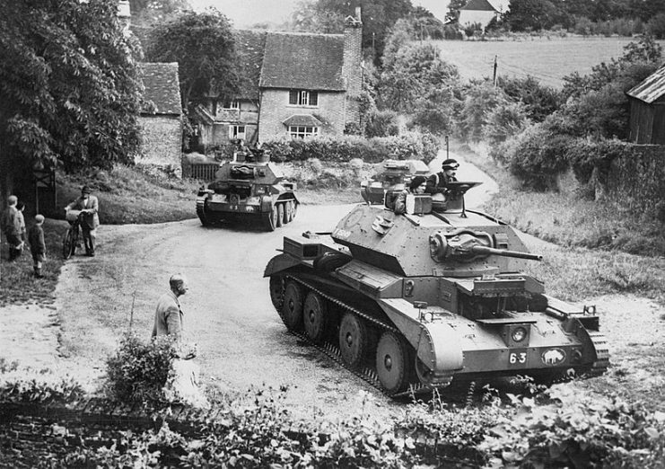 Cruiser Mk IV tanks of 5th Royal Tank Regiment, 3rd Armoured Brigade, 1st Armoured Division, drive through a Surrey village, July 1940.