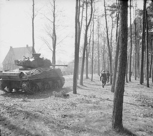Firefly of 5th Canadian Armoured Division assists troops of 49th (West Riding) Division to clear the Germans from Ede, Netherlands, 17 April 1945