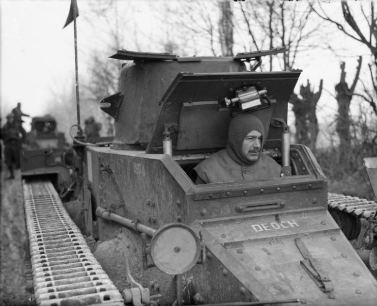 The driver of a Matilda I in France during the winter of 1939–40. This shows the cramped driver's compartment and how the hatch obstructs the gun turret.