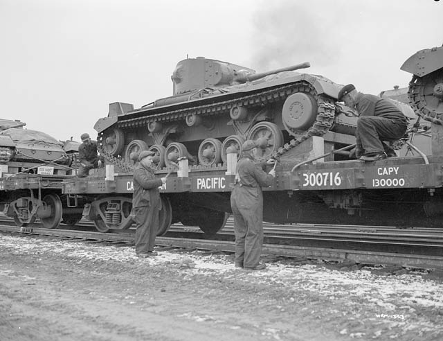 Valentines bound for the Soviet Union being loaded on C.P.R. flat cars